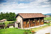 country farmhouse with horse boxes.