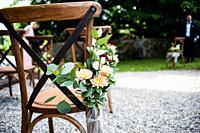 outdoor wedding chairs decorated with flowers.
