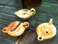 Terra-cotta Oil Lamps of Roman period in â. œDrugstore Galleryâ. . Catacombs in Via Portuense, Rome, Italy.