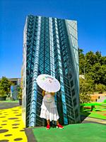 Woman with Japanese sun umbrella posing for a picture at BIODIVERCITY, a public art intervention commissioned by the Musica per Roma Foundation in col...