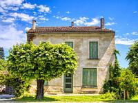 front of a house with bench, Lauzun, Lot-et-Garonne Department, Nouvelle-Aquitaine, France.