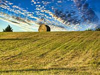 bale of hay on a hill near Lauzun, Lot-et-Garonne Department, Nouvelle-Aquitaine, France.