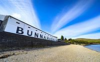Exterior view of Bunnahabhain scotch whisky distillery on island of Islay, Inner Hebrides, Scotland UK.