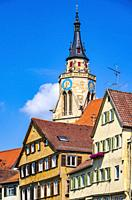 Steeple of St. George´s Collegiate Church and parts of the historical Neckar waterfront of Tübingen, Baden-Württemberg, Germany.