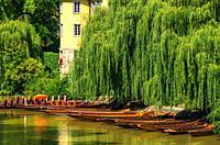 Tübingen, Baden-Württemberg, Germany: Hölderlin Tower and punting boats (Stocherkähne) as part of the ensemble of the historic Neckar Waterfront.