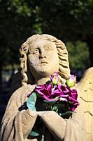 Europe, Luxembourg, Esch-sur-Alzette, Cemetière St Joseph (Saint Joseph Cemetery) with Statue of Angel clutching Flowers.