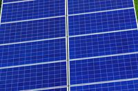 Extreme closeup of cells of a Photovoltaic Panels aka Solar Panels. Green and Clean Energy.