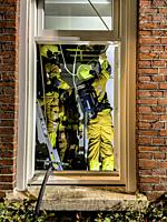 Tilburg, Netherlands. Firemen Fighting a Domestic Fire inside a Residential, Down Town Building.