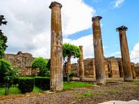 Columns in the house of the Cornelius Family. - Pompeii archaeological site, Italy.
