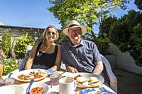 Daughter and father at a lunch table on a terrace in Vancouver, BC, Canada.