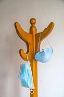 Masks hanging on a coat hanger.