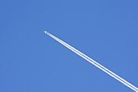 Stele of an airplane and blue sky.