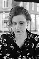 Tilburg, Netherlands. Portrait of a adult, caucasian, blonde woman strolling through down town neigborhoods. Shot on Analog Black & White Film.
