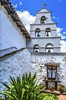 White Abobe Steeple Bells Garden Shrine Mission San Diego de Alcala California. Founded in 1769 by Junipero Serra, first mission in California.