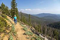 Monarch, Colorado - Susan Newell, 72, hikes on a trail above Monarch Pass near the continental divide.