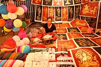 Market stall with posters on the night market, Luang Prabang, Laos