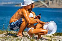 Young couple are going to the beach enjoying view atop the sea
