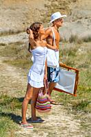 Young couple are going to the beach