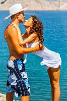 Adolescent teen couple are going to kiss on the beach