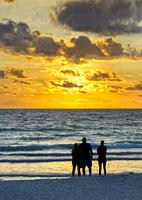 People watching sunset over the Gulf of Mexico from Nokomis Beach in Nokimis Florida USA.
