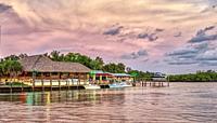 Sunset over Pops Sunset Grill on the Gulf Intercoastal Waterway in Nokomis Florida USA.