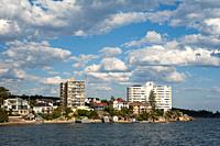 Manly, Sydney, New South Wales, Australia - Cloudscape over residential houses along the waterfront at Smedley's Point, Manly Harbour, a suburb of the...