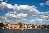 Manly, Sydney, New South Wales, Australia - Cloudscape over residential houses and boats along the waterfront at Manly Harbour, a suburb of the Austra...