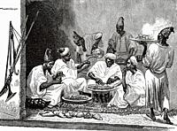 Lunch at the home of the Moroccan war minister. Morocco, Maghreb. North Africa. Old 19th century engraved illustration from El Mundo Ilustrado 1879.