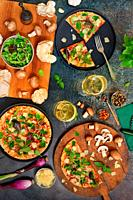 Closeup Table with Glasses With White Wine and Pizza.