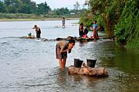 View of Nam Song river at sunset in Vang Vieng, Laos