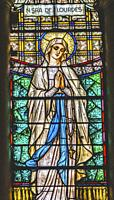 Our Lady of Lourdes Stained Glass Statues Sanctuary Maria Auxilidora Punta Arenas Chile Our lady is the Virgin Mary, who appeared in 1858 in Lourdes F...