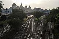 Yangon, Myanmar, Asia - View of train tracks and the Yangon Central Railway Station at dawn.