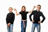 Happy children on a white background, a girl put impromptu pistols to the heads of brothers.