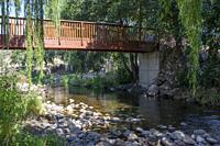 Pedestrian wooden bridge at Ambroz River recreation area of Abadia, Caceres, Extremadura, Spain.