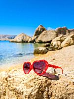 Teenage female sunglasses on Beritnica beach near Metajna on Pag island in Croatia Europe