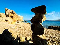 Stacked rocks close-up on Beritnica beach near Metajna on Pag island in Croatia Europe