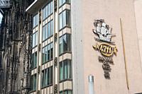 Cologne, Northrhine-Westphalia, Germany, Europe - 4711 Original Eau de Cologne advertising with company logo on a building facade next to the Cologne ...