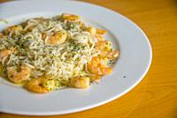 Spaghetti with prawns, parsley and olive oil.