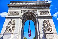 Arc de Triomphe French Flag Paris France. Completed in 1836 monument to the dead in the French Revolution and Napoleonic Wars. Includes tomb to unknow...