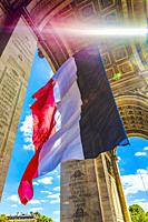 Sunbeam Sun Rays Arc de Triomphe French Flag Paris France. Completed in 1836 monument to the dead in the French Revolution and Napoleonic Wars. Includ...