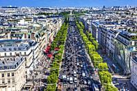Avenue Champs Elysees Shops Traffic Cafes Louvre Buildings Arc de Triomphe View Cityscape City Center Paris France.