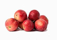 bunch of ripe dark red apples on a white background.