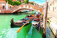 Gondolas moored in the Grand Canal of Venice, Italy.