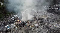 Rotating tracking open burn rubbish at illegal dumping site