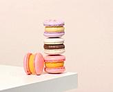 baked round macarons on a white table, delicious dessert.