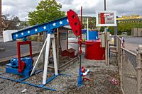 Bradford, Pennsylvania - Cline Oil #1, an oil well drilled in the early 1870s, now located in the parking lot of a McDonald's Restaurant. The well sti...