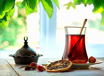 Compostion with fresh turkish tea on a background of window.