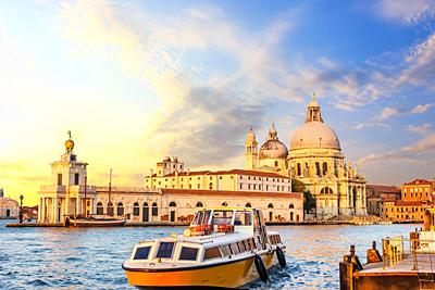 Church of Santa Maria della Salute and the boat near the pier in Venice, Italy.