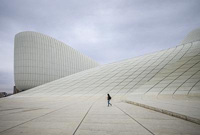 Azerbaijan, Baku, Heydar Aliyev Cultural Center, building designed by Zaha Hadid, exterior with visitors, NR.