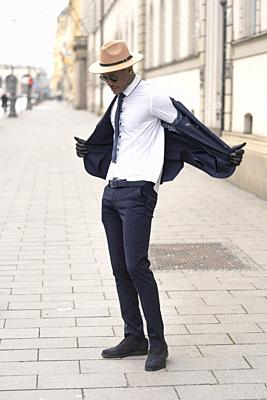 Fashionable man on the street, Munich, Germany.